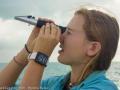 Abigail measures the  salinity as part of the shark tagging data collection.