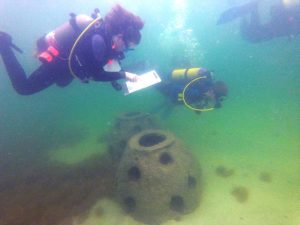 Nauts collect data from recently placed reef balls.
